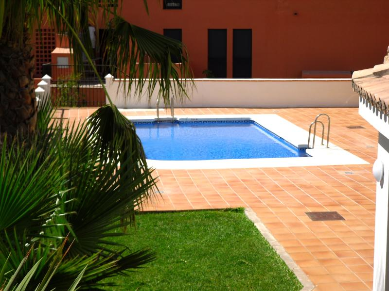 Well kept gardens with three Communal pools.