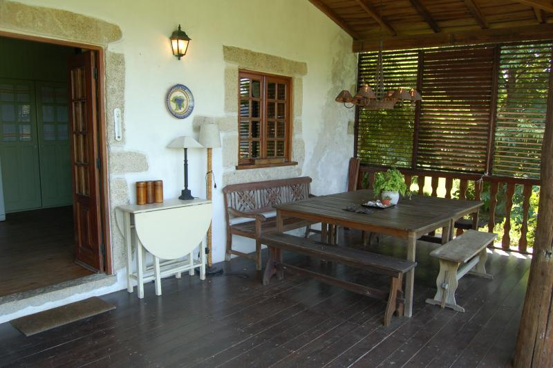 Covered porch with large table for meals alfresco