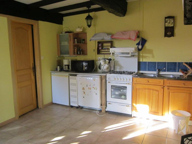 Kitchen with fridge freezer,dishwasher,microwave,gas cooker and washing machine