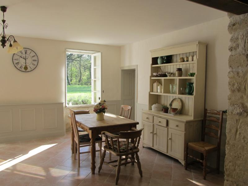 The shabby chic breakfast room of the attached cottage.