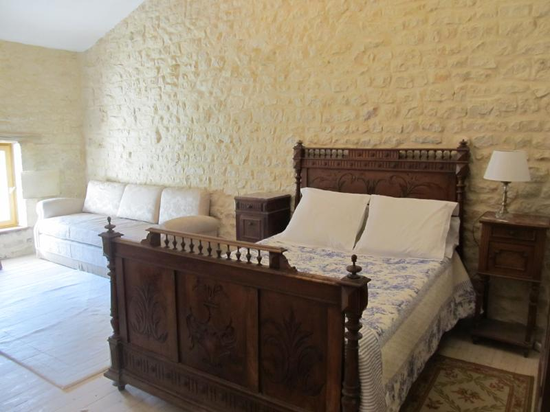 large double bedroom with antique french bed & day beds for children sharing