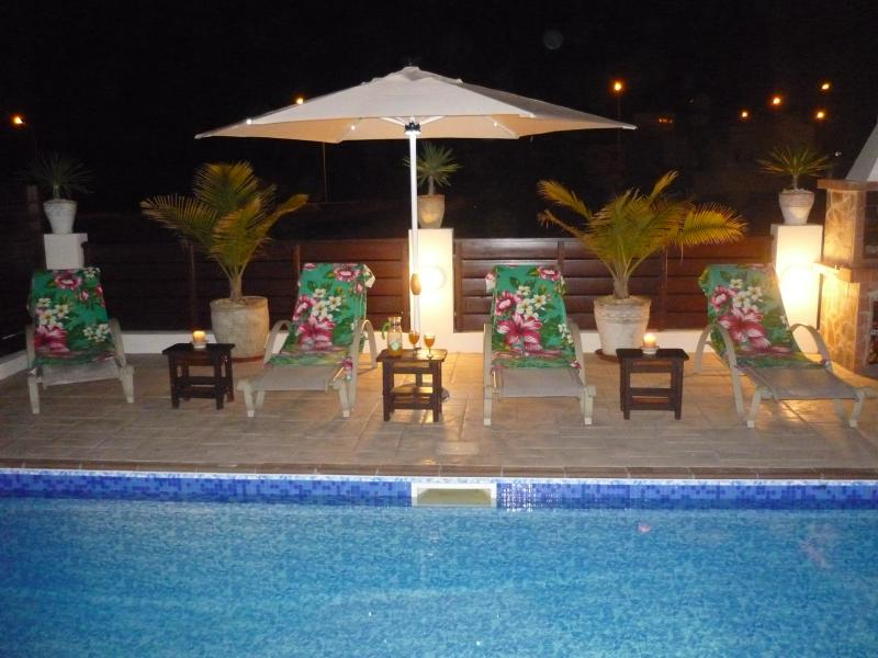 Why not relax and enjoy a drink around your own private pool at night