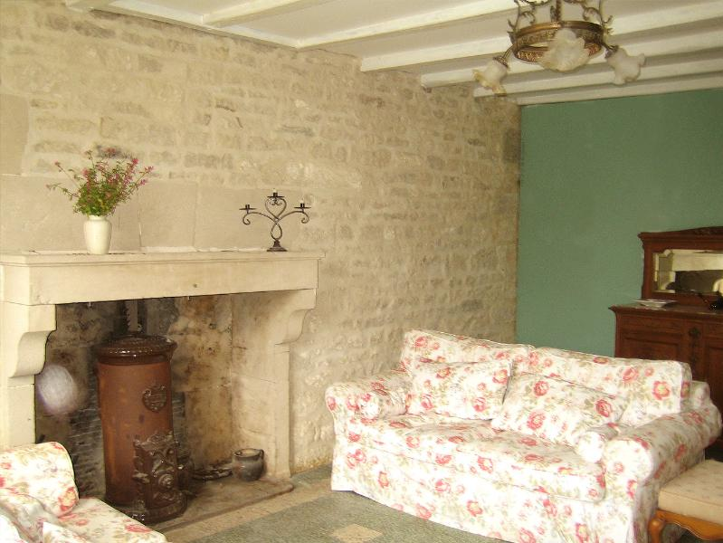 cottage-style sitting room with comfy sofas, original fireplaces, & wood-burning stove TV &