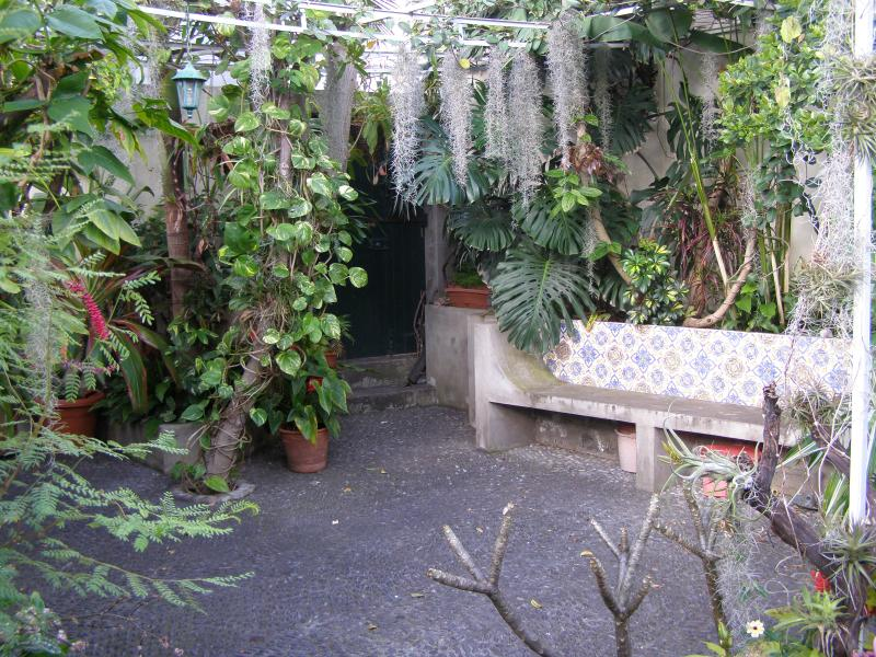 Your back garden gate accesses the pebbled courtyard garden with traditional Madeiran tiled seating.