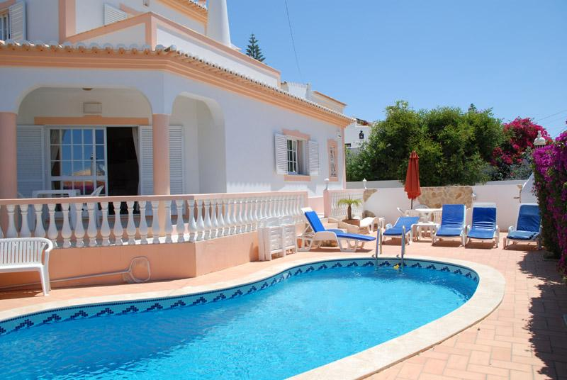 Villa pool has plenty of sunbeds and chairs