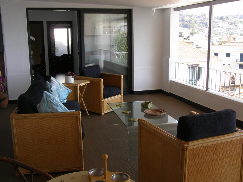 Looking back into the apartment & out over the city from your open air covered terrace