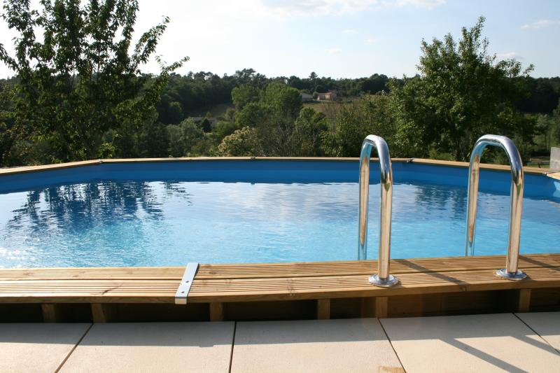 The countryside beyond the pool