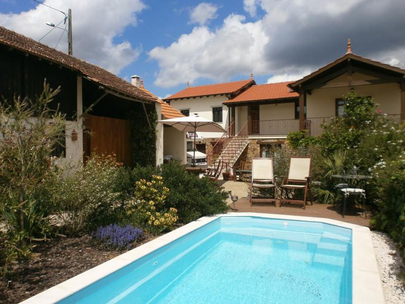 Relax by the pool in the pretty courtyard garden