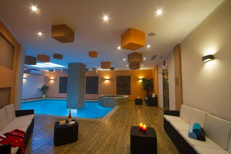 communal indoor pool area with jacuzzi