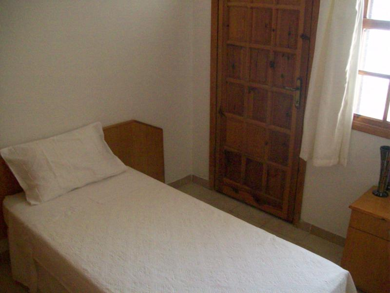 Singel bedroom. Room opens to balcony.