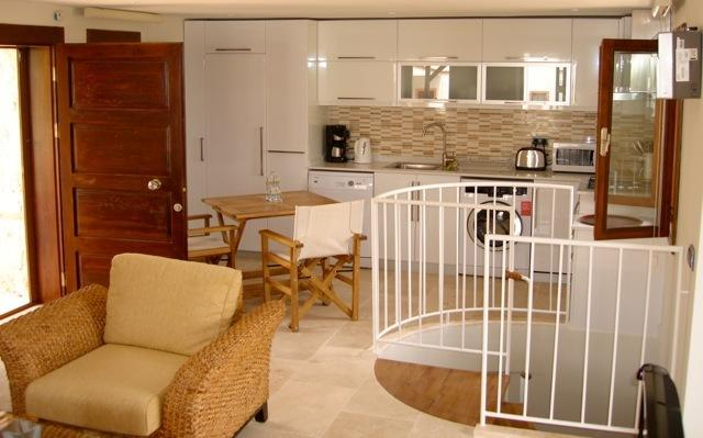 Open plan lounge and kitchen with modern appliances