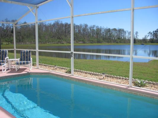 4 Bed/2 bath luxury villa. South-facing, Overlooking Lake, furnished patio, 30ft private pool.