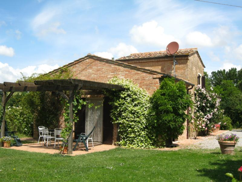 view over pergola and holiday cottage from main garden