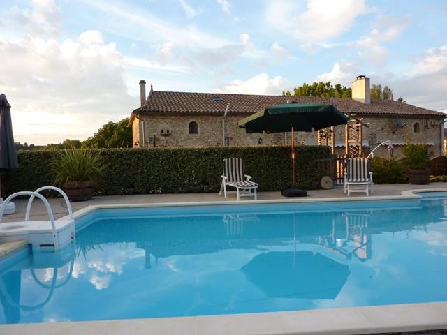 pool to farmhouse view