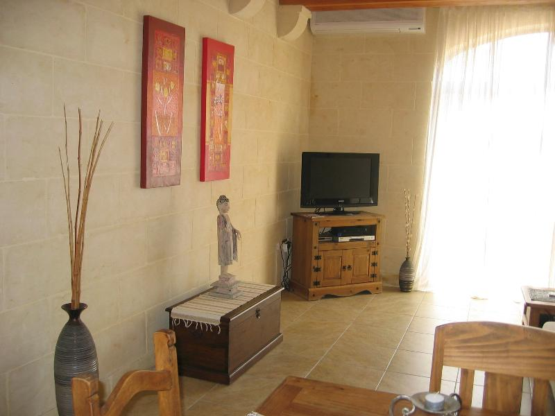 Lining room and dining area, with direct access to private patio