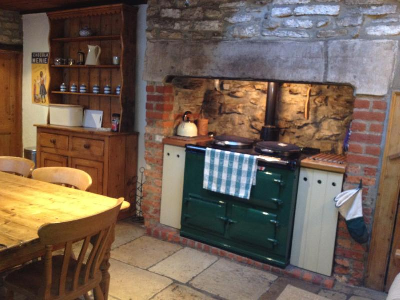 Chill out in the farmhouse kitchen with the Aga