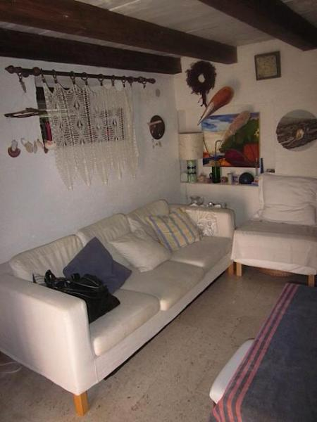 Marble living room with cozy sofa and TV and DVD player