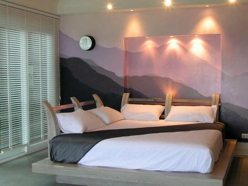 This room ha two way bed with the Samui Hills on the backdrop wall behind, with a view to die for !!