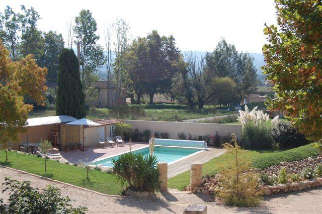 POOL AT LA GRANDE TERRE WITH SEATING UNDER SHADE, BBQ, FRIDGE AND KITCHEN AREA. SUN LOUNGERS, CHAIRS