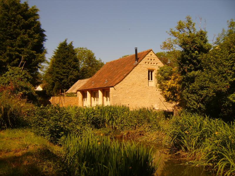 Dovecote Barn and moat, head of the River Avon .
