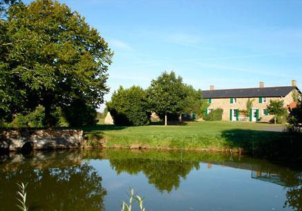 Farmhouse, pond and bridge