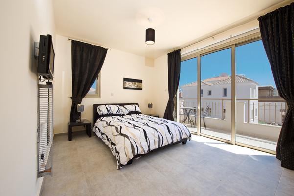 Master bedroom showing patio doors & balcony.