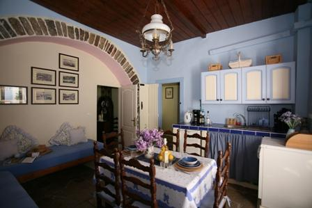 Dining kitchen with air con and an additional 2 Greek style bed settees for relaxing