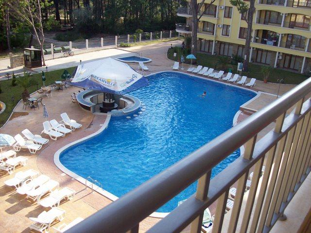 Enjoy a glass of wine on the large balcony over looking pool