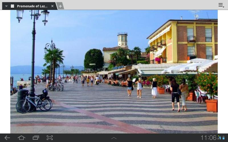 the promenade  of Lazise with restaurants and shops