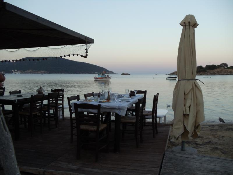 Enjoy a meal at beach side restaurant. Near Kavala, Greece