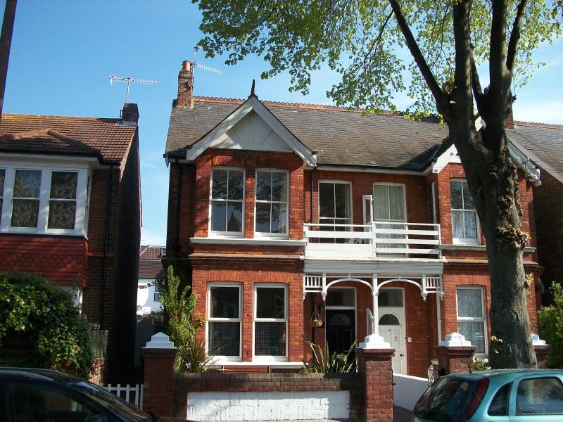 Front of apartment, showing bay window and balcony