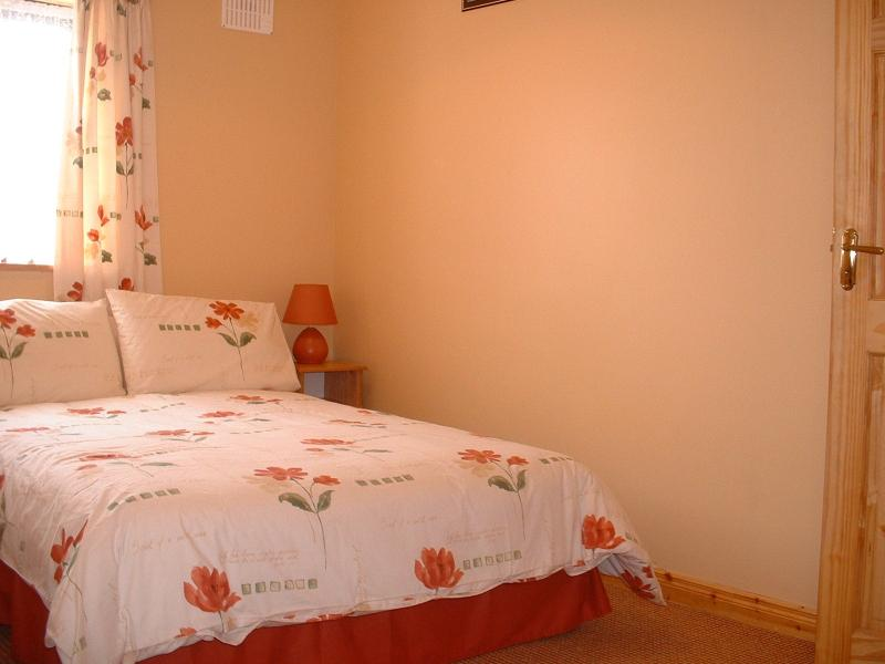 Large bedroom with double and single beds  ,ensuite bathroom with bath and shower,