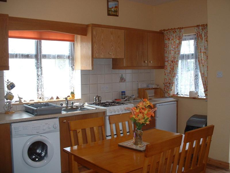 Kitchen with everything you need to self-cater  for an enjoyable holiday .