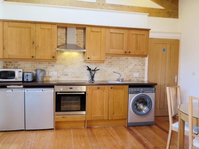 South Byre has a sociable open plan kitchen/dining /living area with fabulous beamed ceiling
