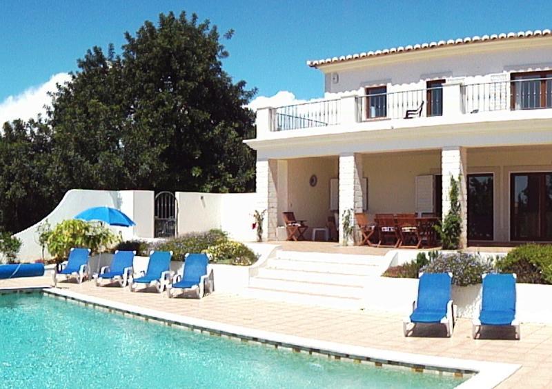 Villa, pool and ancient carob tree