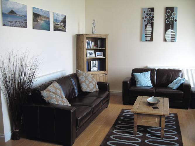 Open plan lounge. Extensive views across Penzance Harbour, Mounts Bay and St Michaels Mount. TV, DVD
