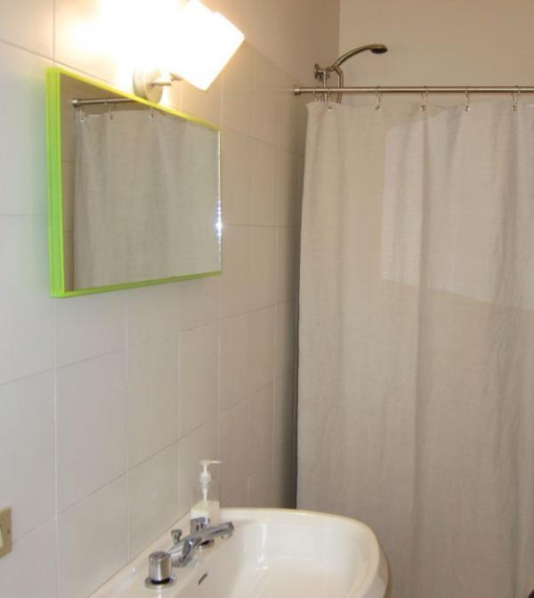 Bathroom with shower, sink, bidet, hair dryer