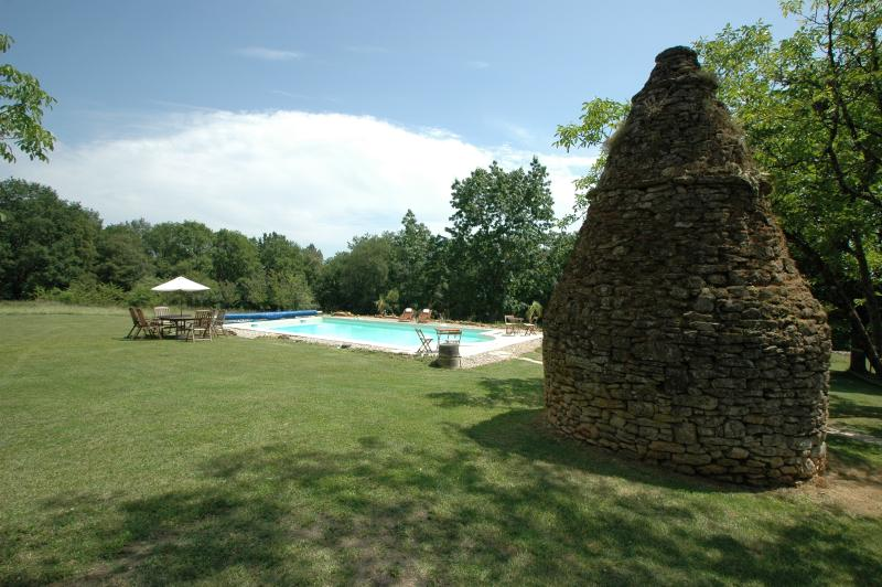 Ancient stone borie next to the pool