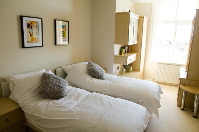 Comfortable twin bedroom with sea views.
