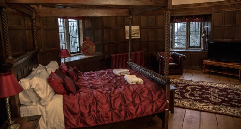 The stunning four-poster bed located in the master bedroom