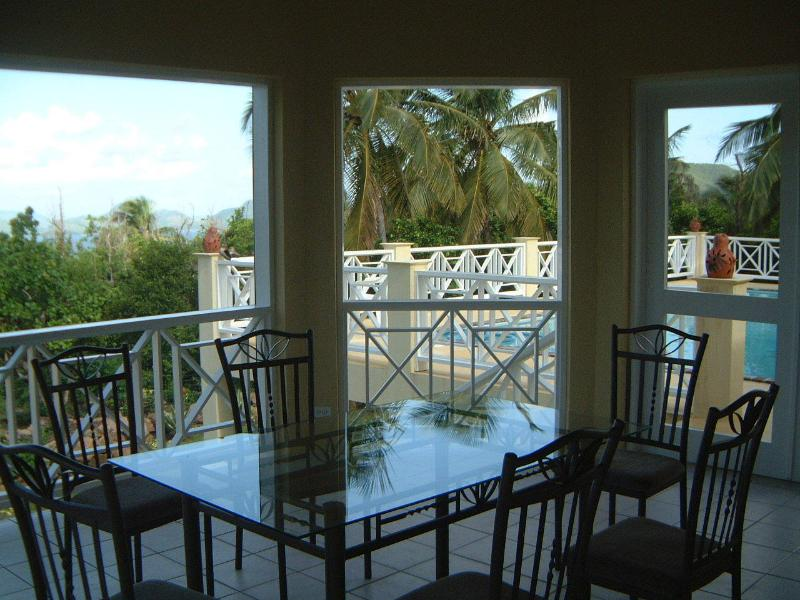 Covered porch.  Perfect for dining and watching the sunsets over the Caribbean