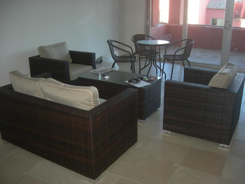 Lounge (showing all garden furniture) and covered patio