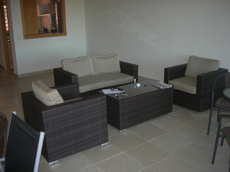 Lounge with kitchen in background