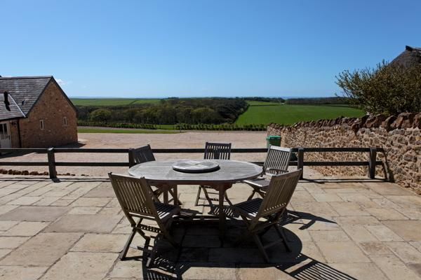 Terrace overlooking farmland with the ocean beyond