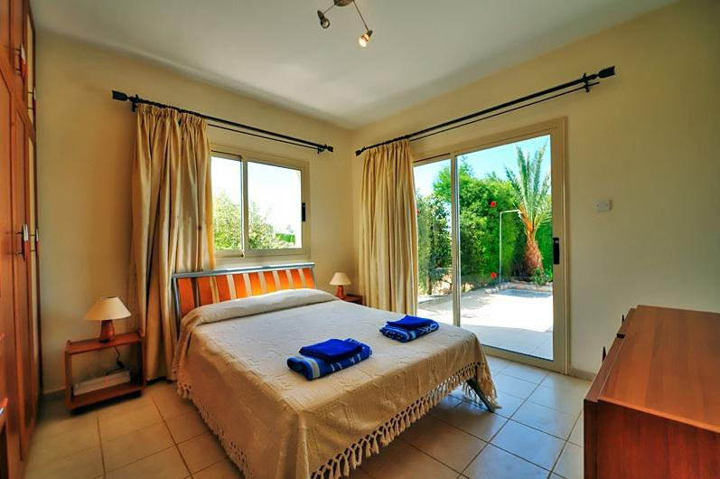 Master Bedroom (Ground Floor) Fully fitted with en-suite shower room, Veranda and Sea Views vi