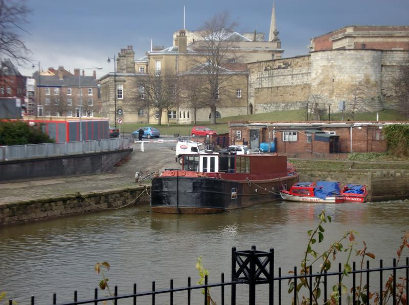 Garden View over the River Foss Lock and Castle Walls