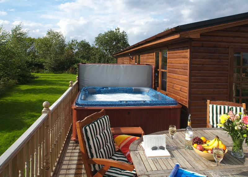 Large deck with private hot tub, ideal for relaxing after a busy day.