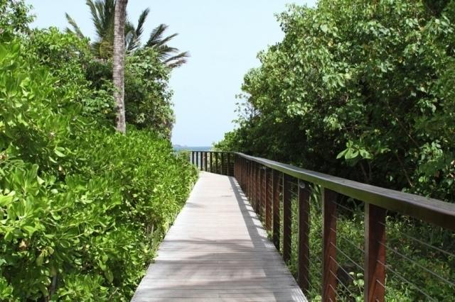 The walkway to the beach and one of the many resort restaurants.