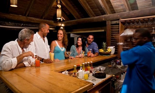 The beach bar as seen at night is a great social spot.