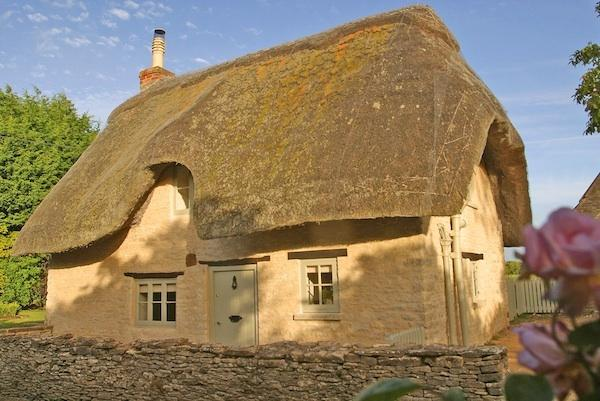 Picture postcard thatched cottage in a pretty village